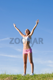 Stretching young sportive woman meadows sunny day