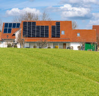 Innovative House with solar collectors- building modified by image editing