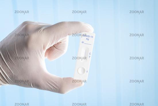 Covid-19 rapid antigen test. Rapid antibodies test kit in hand.