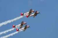 Four Yakovlev Yak-52/50 planes in tight formation