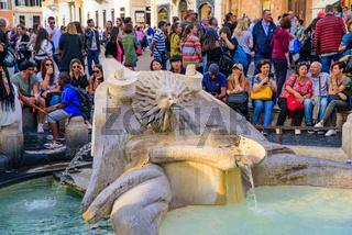 Fontana della Barcaccia at the bottom of the Spanish Steps in Piazza di Spagna (Spanish Square) in Rome, Italy