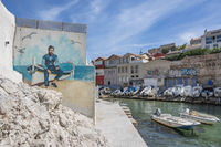 Street Art and boat: Port de Malmousque at Marseille's cliff coast.