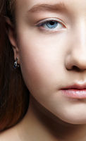 Closeup shot of human teenager girl half face. Young female with natural face and eyes beauty makeup