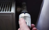 turning off thermostat on radiator to save energy due to increasing heating costs