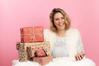 Attractive middle age woman with christmas gifts