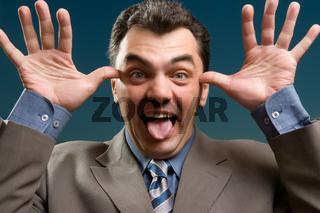 businessman shows tongue close up