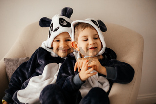 the kids dressed in comfortable animal costumes