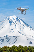 Flight drone quadcopter UAV background volcano filming aerial video world around from birds eye view