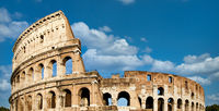 Rome, Italy. Arches archictecture of Colosseum exterior with blue sky background and clouds.