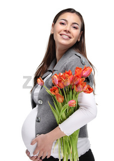 Happy pregnant woman with tulips