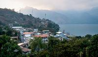 Last light over volcanic mountain range along lake Atitlan in San Pedro la Laguna, Guatemala
