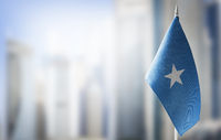 A small flag of Somalia on the background of a blurred background