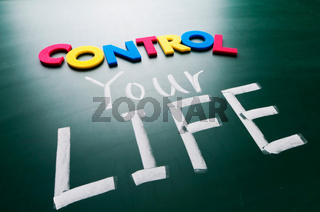 control your life, conceptual words on blackboard.