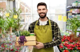 happy gardener or seller with box of garden tools