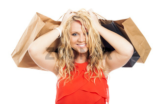 Attractive blond happy woman shopping