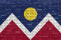flag of Denver painted on brick wall