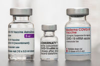 original vials with vaccine against covid-19 virus