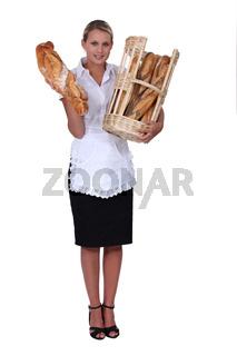 Blond bakery worker holding bread