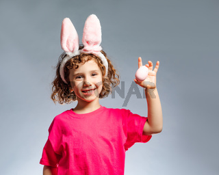 the little girl dressed in traditional Easter clothes