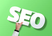 hand holding SEO sign against green background