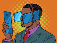 Black man with smartphone. Dependence on gadgets. The phone prevents you from seeing