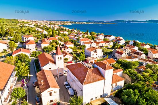 Zadar. Village of Diklo church and coastline in Zadar archipelago aerial view