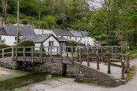 HELSTON, CORNWALL, UK - MAY 14 : Wooden bridge over the stream in Helston, Cornwall on May 14, 2021