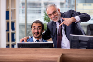 Two businessmen employees working in the office