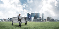 Young businessman or student studying the science and cityscape at background