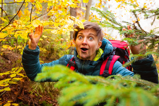 The surprised woman in the autumn forest