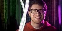 man in glasses over neon lights and binary code