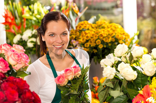 Smiling florist flower shop colorful making bouquet