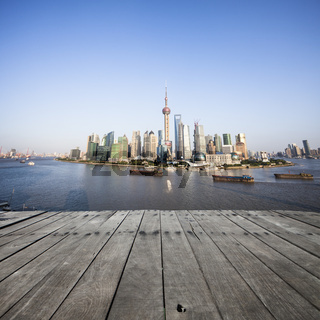 landscape of modern city with wooden floor