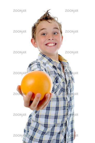 Little kid holding fresh oranges.