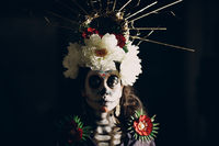 Woman with mexican skull halloween makeup on her face. Day of the dead and halloween