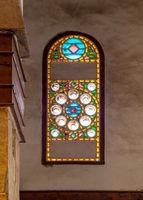 Mamluk era perforated stucco window with colorful stain glass with circular geometrical patterns, Beshtak Palace