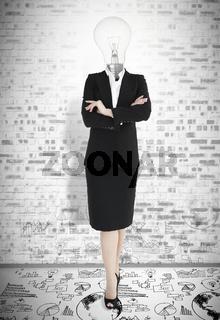 Businesswoman with head light bulb