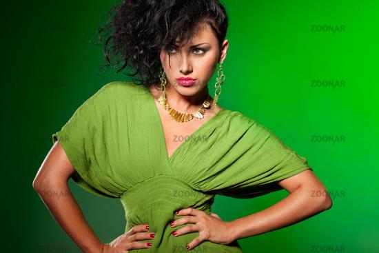 elegant fashionable woman on green