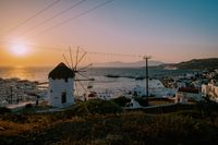 Sunset Mykonos Greece , colorful streets of the old town of Mykonos with tourist in the street