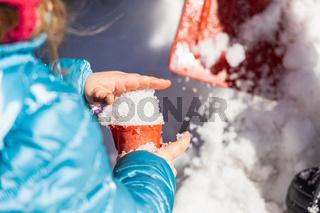 Outdoor activities in a canadian kindergarten during a winter day