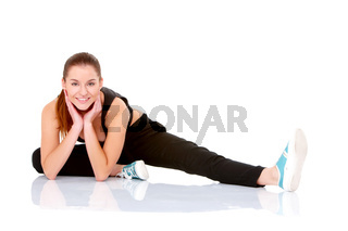 Beautiful fitness woman doing stretching exercise