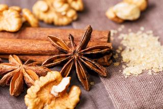 Star anise walnut brown sugar with cinnamon on cloth background