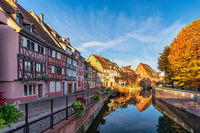 Colmar France, colorful half timber house city skyline at Ill River with autumn foliage season