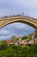 MOSTAR, BOSNIA AND HERZEGOVINA - SEPTEMBER 05: Jumping from the Old bridge on September 05, 2015 in Mostar, Bosnia and Herzegovina