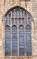 old window on the historic medieval cartmel priory in cumbria now the parish church of st micheal and mary
