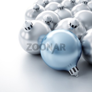 Christmas toys of silver color in the form of spheres on a white background