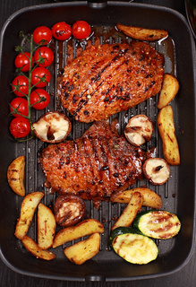 Delicious beef steak with grilled vegetable and mushrooms