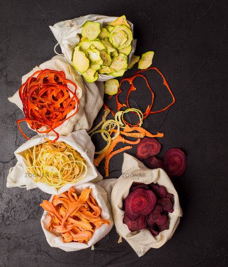 Dehydrated vegetables in textile bags on black