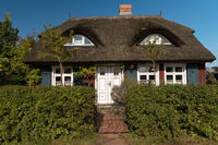 BORN ON DARSS, GERMANY - OCTOBER 06, 2021: The village is known for its picturesque colorful thatched roof houses with traditional motifs.