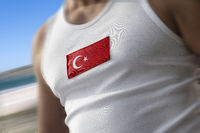 The national flag of Turkey on the athlete's chest
